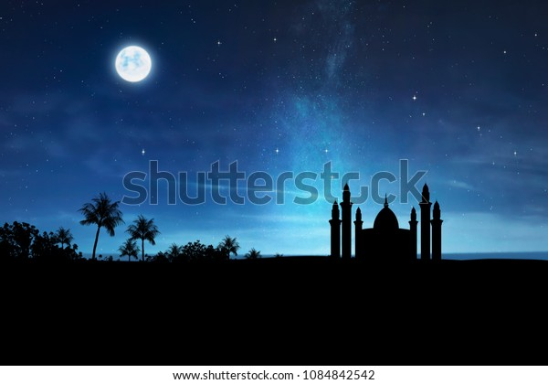 Silhouette of mosque with high minaret on the night