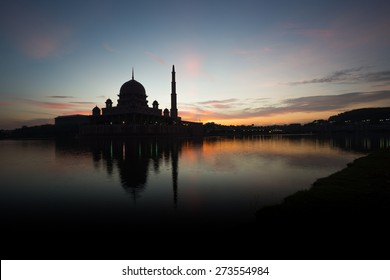 A silhouette of a mosque / The Putra Mosque silhouette  / A mosque at dawn / Sunrise clouds above mosque