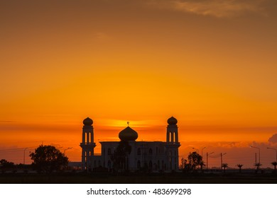 A silhouette of a mosque at sunrise vivid color , Thailand