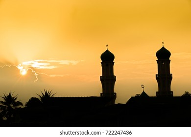 A silhouette of a mosque at sunset in Nakhon Sri Thammarat, Thailand