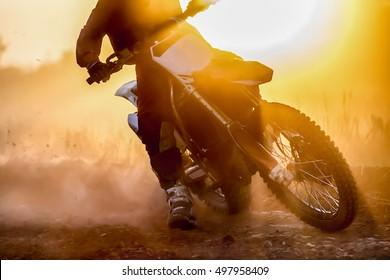 Silhouette motocross speed in track