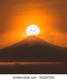 Silhouette of Mount Fuji at Lake kawaguchiko in Japan on sunrise.