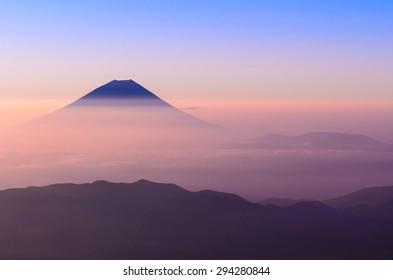 Silhouette of Mount Fuji as seen from Mount Kitadake.
