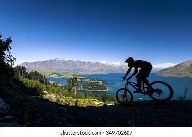 Silhouette of mountain bike rider in Queenstown, New Zealand