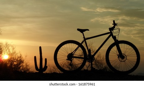Silhouette of a mountain bike at sunset