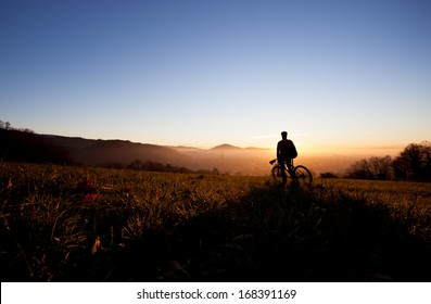 silhouette of mountain biker in sunset