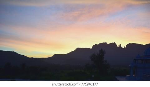 Silhouette mountain blue orange sky