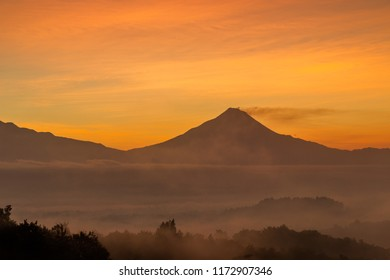 Silhouette of mountain surrounded by morning mist in Magelang, Indonesia.