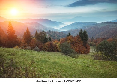 Silhouette of mountains in the early misty morning. View of the mountains in early spring. Beautiful nature landscape. Carpathian mountains. Ukraine