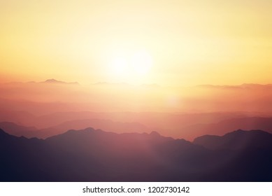 Silhouette of mountains at sunset in the evening at dusk Mount Moses Sinai Egypt Landscape with aerial perspective, air fog