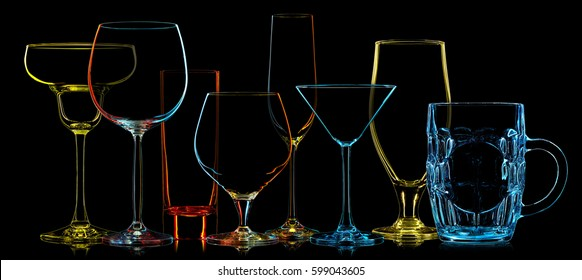Silhouette of multicolor different glasses on black background