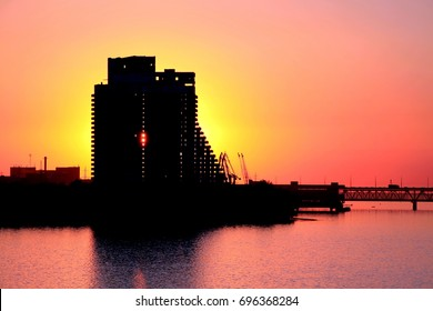 Silhouette of a multi-storey building and a bridge in Dnepr city at sunset Dnepropetrovsk, Dnipropetrovsk, Dnipro , Dnieper,  Ukraine.