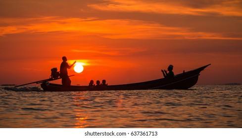 Silhouette : Muslim pray blessings on board the sea.