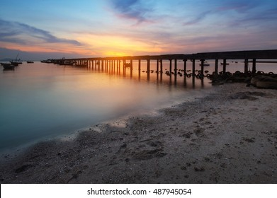 Silhouette natural background of jetty during time the sunset and the beautiful natural of the colorful sky at BangPhra beach , Chonburi province in Thailand