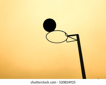 Silhouette netball and goalpost