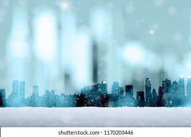 Silhouette of New York / Manhattan with falling snow and nice freezing blue tone bokeh in background.