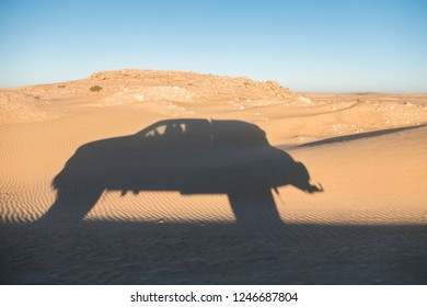silhouette of off road car in the sand of Sahara desert