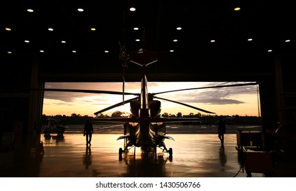 an silhouette offshore helicopter in hangar for support morining operation