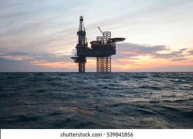 Silhouette of offshore oil drilling rig