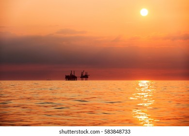 Silhouette of offshore oil installation