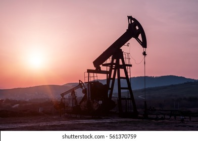 silhouette of oil pump on beautiful red sunset