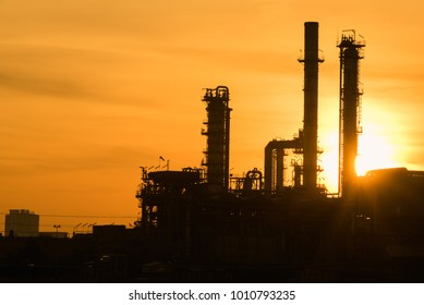 Silhouette Oil Refinery industry plant at sunrise dawn sky morning background.