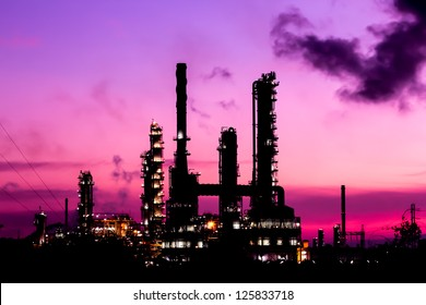 silhouette oil refinery plant and smoke at twilight morning