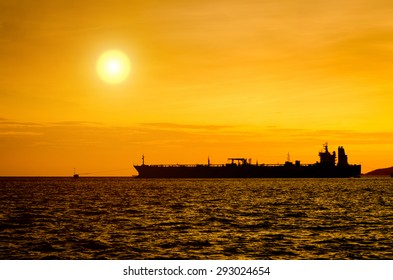 Silhouette of Oil Tanker in the sea at sunset