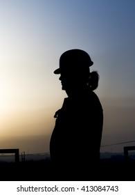 Silhouette of oilfield worker in the oilfield