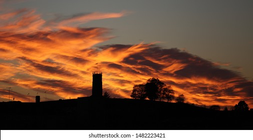Silhouette of old viking castle tower with sunset clouds in oldest city Tonsberg Norway