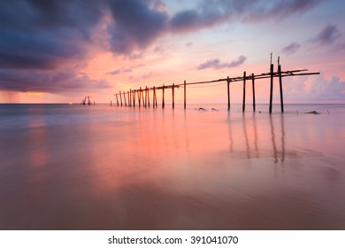 Silhouette old wooden bridge with colorful sunset , Phang-Nga , Thailand