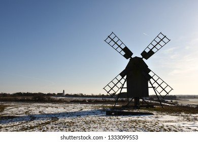 Silhouette of an old wooden windmill in winter season at the swedish island Oland