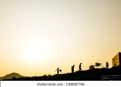 silhouette on sunset field