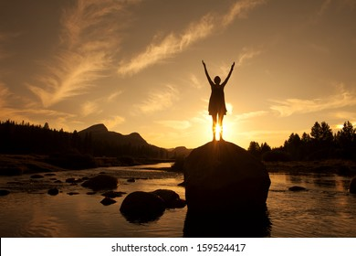 Silhouette of Outdoor Yoga, Young Woman in Sun Salutation