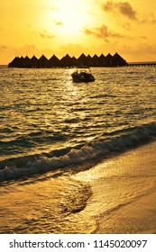 Silhouette of over water bungalows during beautiful tropical sunset