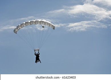 Silhouette of a parachute tandem jump