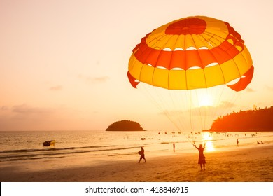 Silhouette of Parasailing at Kata beach with sunset, Phuket, Thailand.
