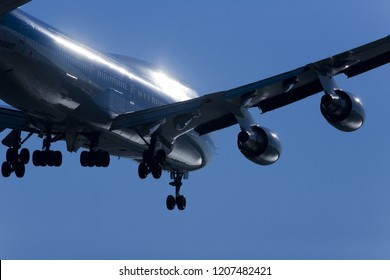The silhouette of a passenger plane flying