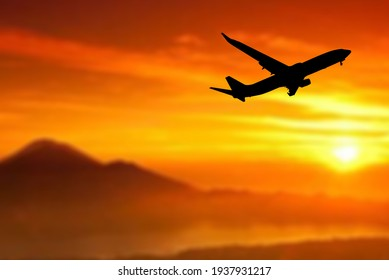 Silhouette of a passenger plane taking off from the airport