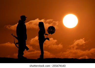 Silhouette of peace and love versus war and anger. No war, soldier and girl, weapon and flower toy, peace in world, sunset, landscape