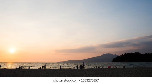 silhouette of people at the beach