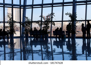 silhouette of people in a business center