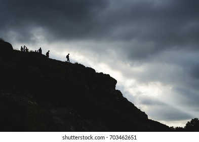Silhouette of people hiking at the mountain.