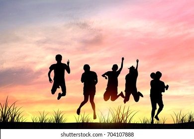 silhouette people jumping in sunset because of happiness, success and celebration in business and improving to goal.