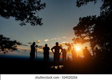 silhouette people on mountain in sunset time