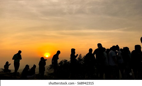 Silhouette people on top of mountain before sunset, Mountain Thailand