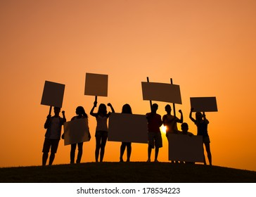 Silhouette of People Protesting at Sunset