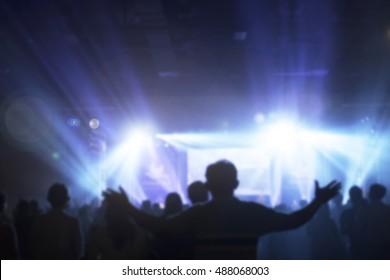 Silhouette people raising hand