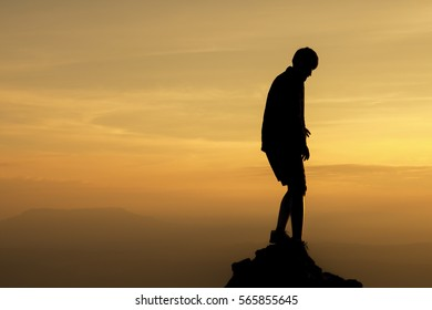 silhouette of people relax at the cliff and mountains with sunset in the evening