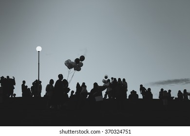 Silhouette of people relaxing at a park